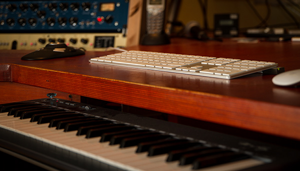 Desktop with Keyboard and Piano